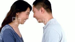 Happy Asian couple looking in each others eyes