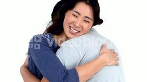 Happy Asian couple hugging each other