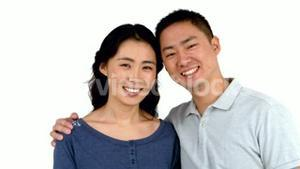 Portrait of Asian smiling couple posing