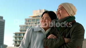 Loving Asian couple in winter clothes posing