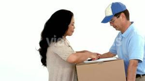 Delivery man getting signature from customer
