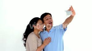 Couple taking selfie and grimacing