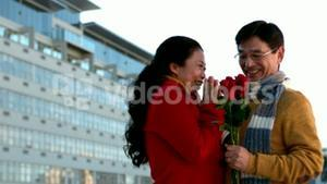 Happy romantic couple with a flower