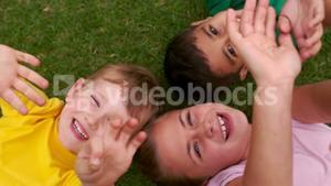 Smiling children forming a huddle in circle