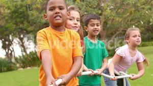 Kids pulling a large rope