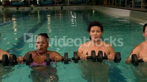 Pregnant women using weights in the pool