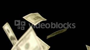 Dollars blowing on black background