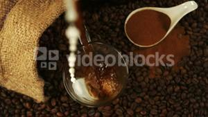 Coffee pouring into a glass cup