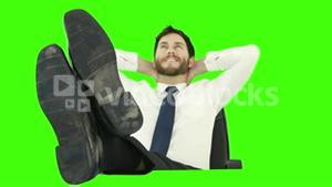 Businessman relaxing in his chair with legs up