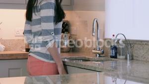 Asian woman turning off the tap