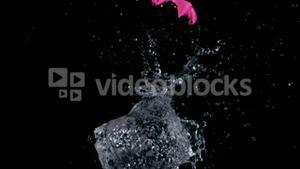 Big pink water balloon exploding