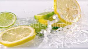 Lemon slices falling into water