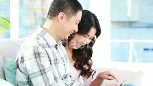 Happy couple using smartphone together