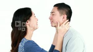 Happy Asian couple kissing and smiling