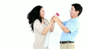 Asian woman giving a gift to her husband