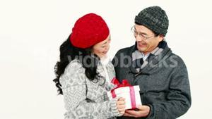 Happy Asian couple holding a present