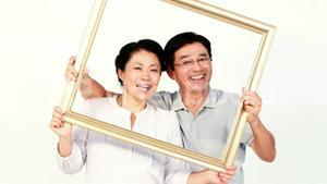 Happy Asian couple holding a square