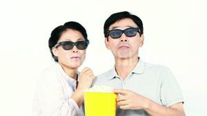 Asian couple watching a 3D movie