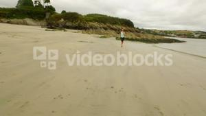 Fit woman running on the sand