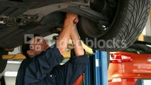 Female mechanic working on a tire