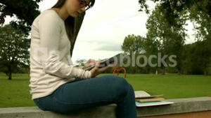 Pretty woman studying with books and tablet