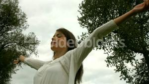 Pretty girl with arms outstretched
