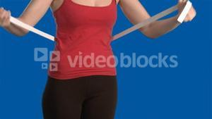 Blue Screen of woman measuring her waste