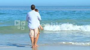 Cute couple playing on the beach