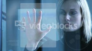 Businesswoman touching a security system