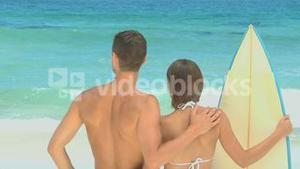 Cute couple with surf board