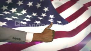 American flag blowing with thumbs up