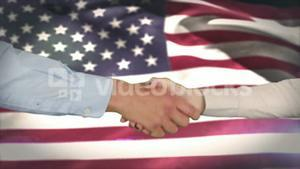 Hands shaking against american flag