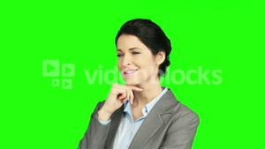 Thinking businesswoman with hand on chin