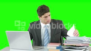 Worried businessman using laptop at desk