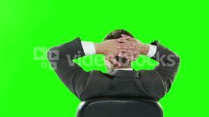 Rear view of businessman relaxing in his chair