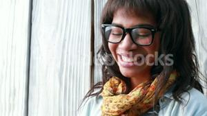 Smiling hipster woman using tablet