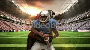 Serious american football player tackling for ball