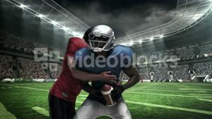 American football player tackling for ball