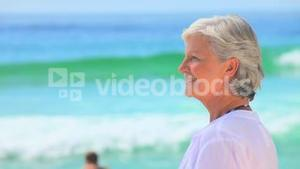 Elderly woman looking far away and smiling