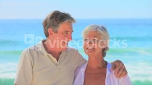Happy mature couple on a beach