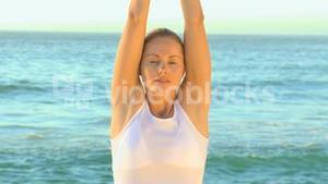 Woman in white doing yoga
