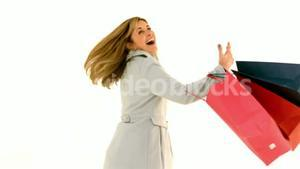 Woman spinning with shopping bags
