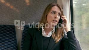 Businesswoman using phone on the train