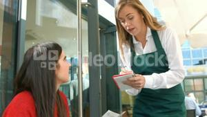 Waitress taking an order in cafe