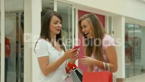 Happy friends in the shopping mall