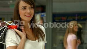 Happy brunette in the shopping mall