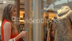 Happy blonde in the shopping mall