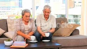 Elderly couple drinking a cup of tea