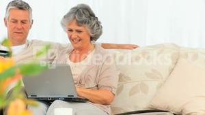 Mature couple buying something on the net