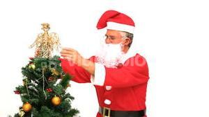 Santa Claus decorating the Christmas tree